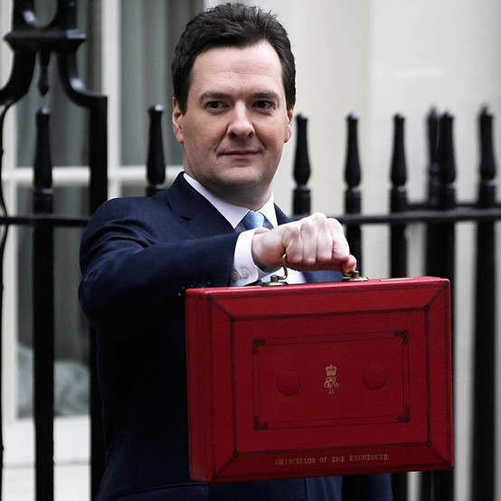 Chancellor of the Exchequer George Osborne walks out before presenting his annual budget to Parliament at 11 Downing Street