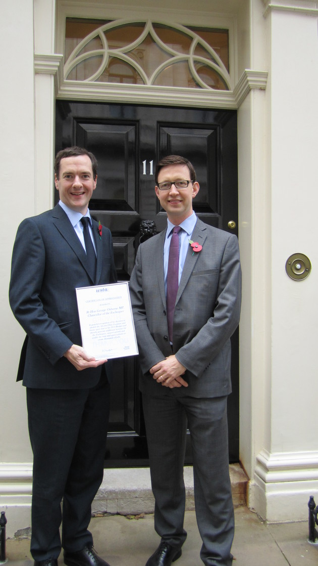 Miles Beale, the chief executive of the WSTA, presented The Chancellor of the Exchequer, George Osbourne an award